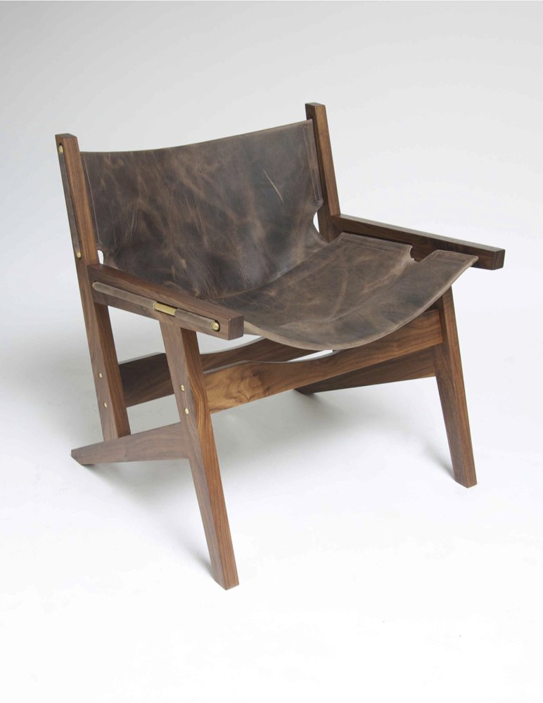 Part of the appeal of the Peninsula chair is that the sling is attached using just brass rods. Should you even want to change the sling, merely slide them out and do so.  Photo 1 of 4 in Phloem Studio's Peninsula Chair