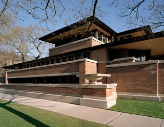 "Robie House, Chicago, Illinois (1910)""Early in life I had to choose between honest arrogance and hypocritical humility. I chose honest arrogance."" It should come as no surprise who uttered those words—the architect of the famed Robie House, Frank Lloyd Wright. The residence, with its tight recessed entry leading to dramatic light-filled openness, seamless space unencumbered by needless partitions, continuous bands of windows, its horizontal, low-slung form, and overhanging eaves, is what the architect called ""a cornerstone of American architecture."""