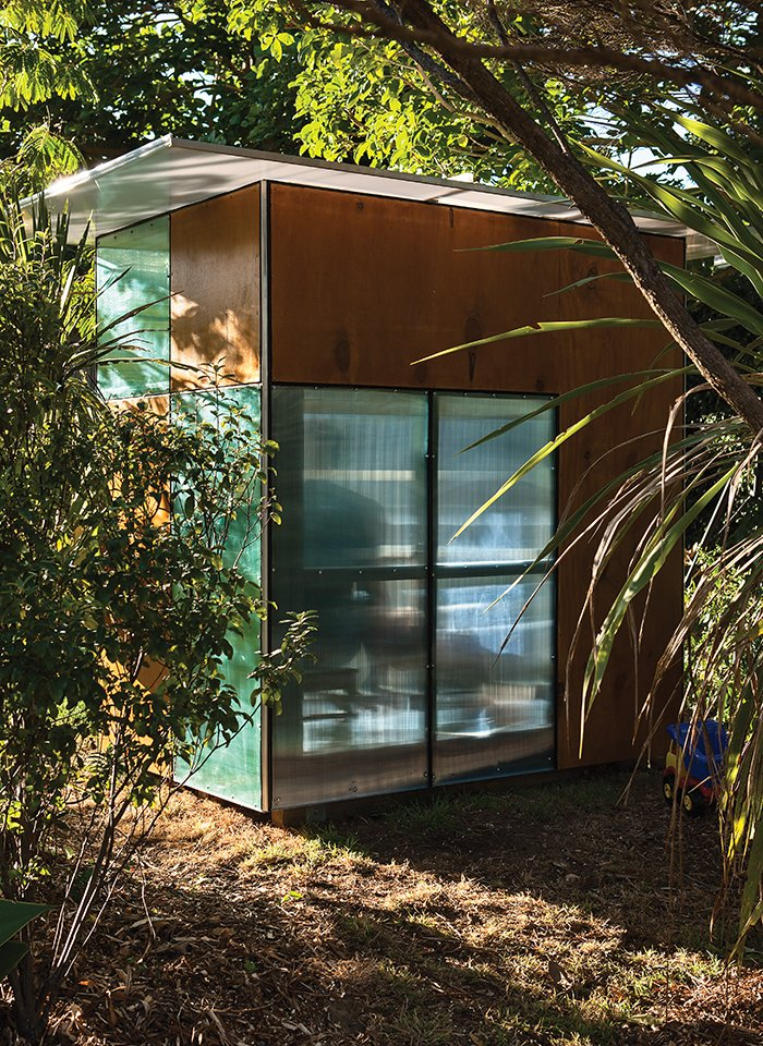 The Case Study–like structure is framed in timber and clad in alternating modules of stained plywood and colorful, semitransparent polycarbonate.  Plywood-Loving Prefabs by Andrea Smith