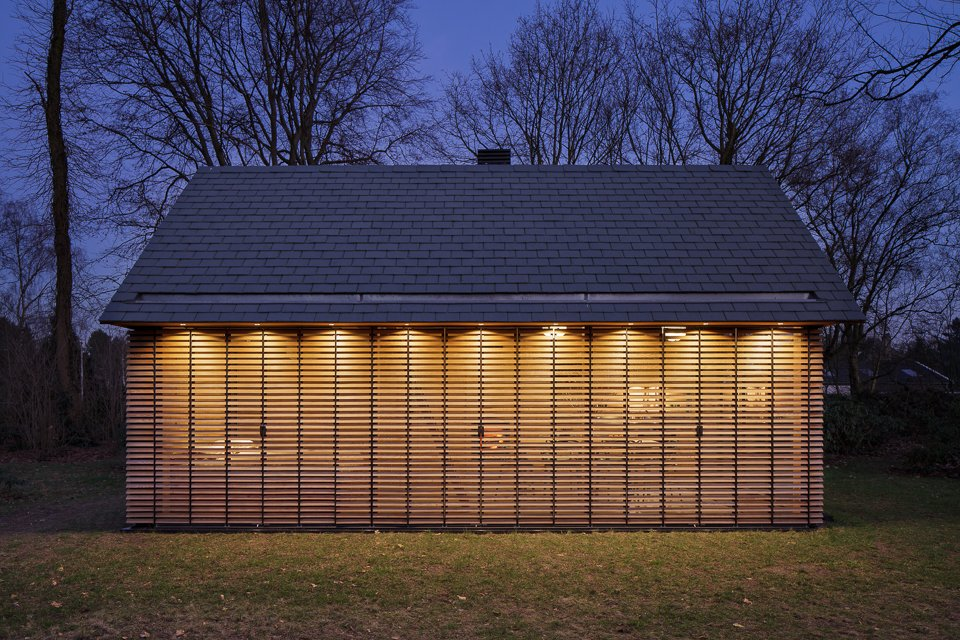 Exterior, House Building Type, Cabin Building Type, Shingles Roof Material, and Wood Siding Material When the shutters are closed, the house assumes an introverted character.  Utrecht Cabin by Laura C. Mallonee