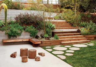In another section of the yard, Cooper added varying-sized circular cement stepping stones, which lead toward an elevated planter filled with California-native plants.
