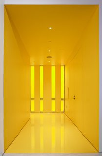 The yellow hall gives a bolt of energy as you head into to the lecture hall. © Greg Irikura 2013.
