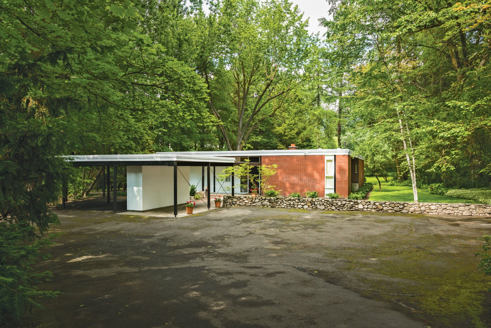 Exterior, Mid-Century Building Type, House Building Type, and Brick Siding Material The view as it appears today.  Mid Century from A 1950s Mid-Century Home Joins the Spokane Register of Historic Places