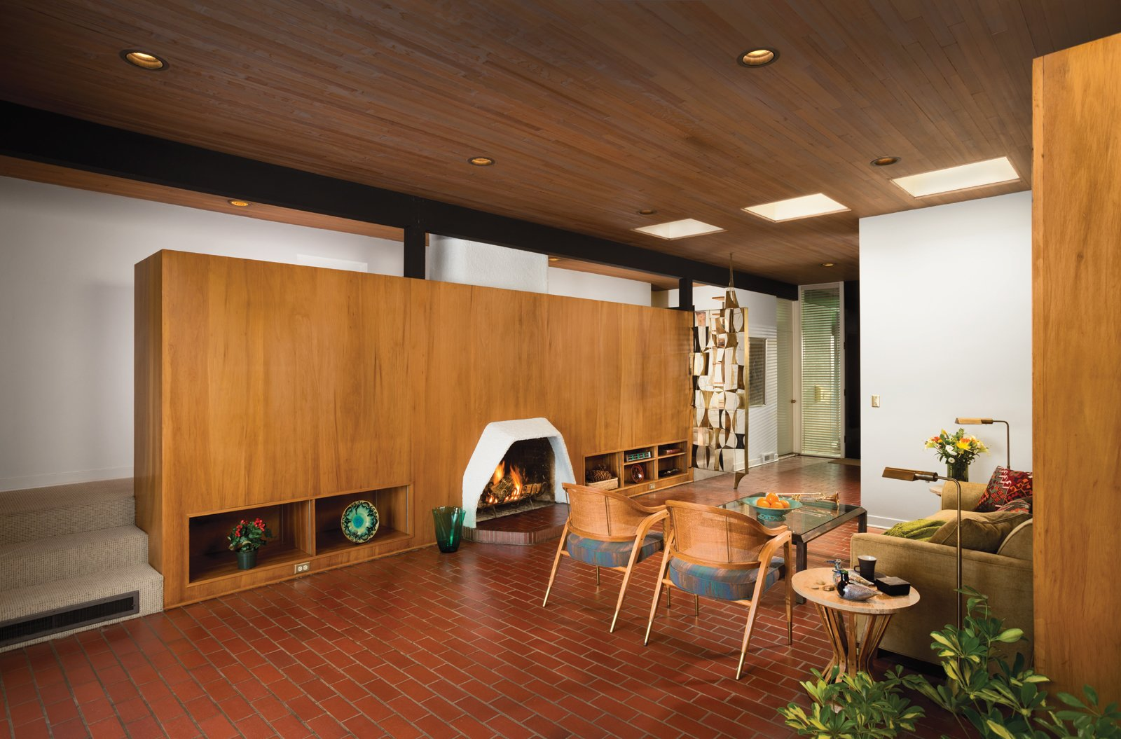 Living Room, Wood Burning Fireplace, Brick Floor, and Standard Layout Fireplace The living room features two side chairs and an end table by Edward Wormley for Dunbar and a bronze screen designed by Harold Balazs.  Photo 3 of 4 in A 1950s Mid-Century Home Joins the Spokane Register of Historic Places