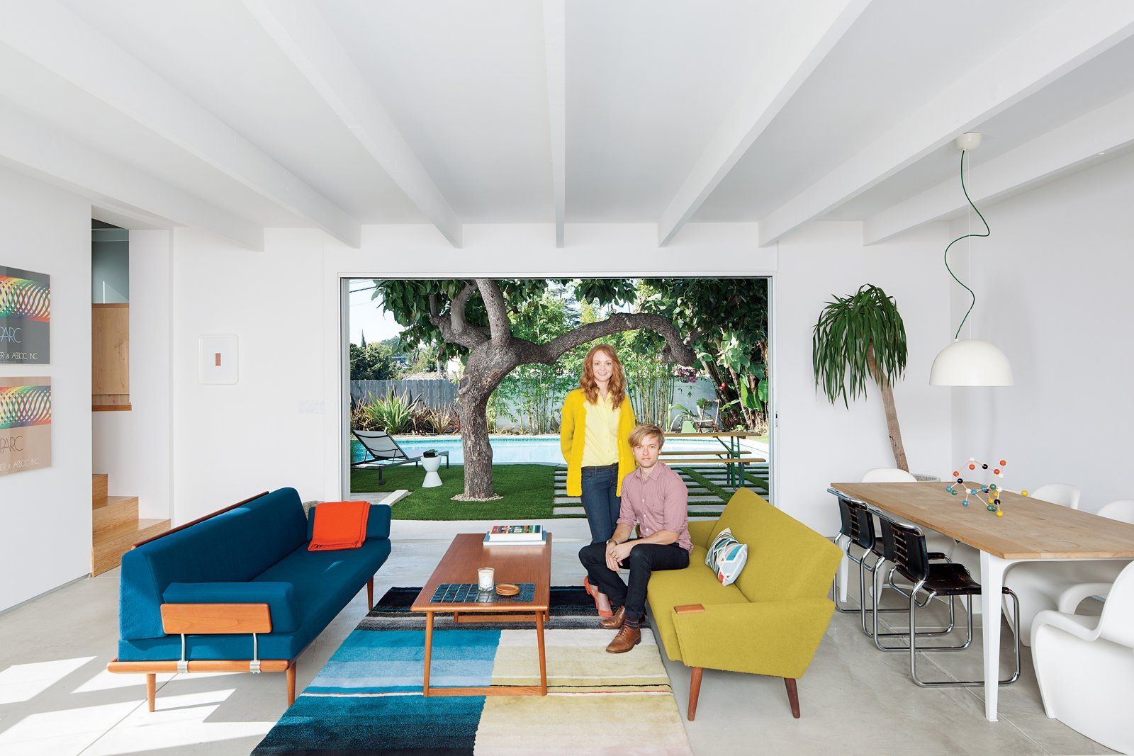 Living Room, Sofa, Coffee Tables, and Pendant Lighting Glee star Jayma Mays and actor Adam Campbell in the living room of their Los Angeles home.  Modern and Young: A Furniture-Filled Living Room in Los Feliz by Eujin Rhee