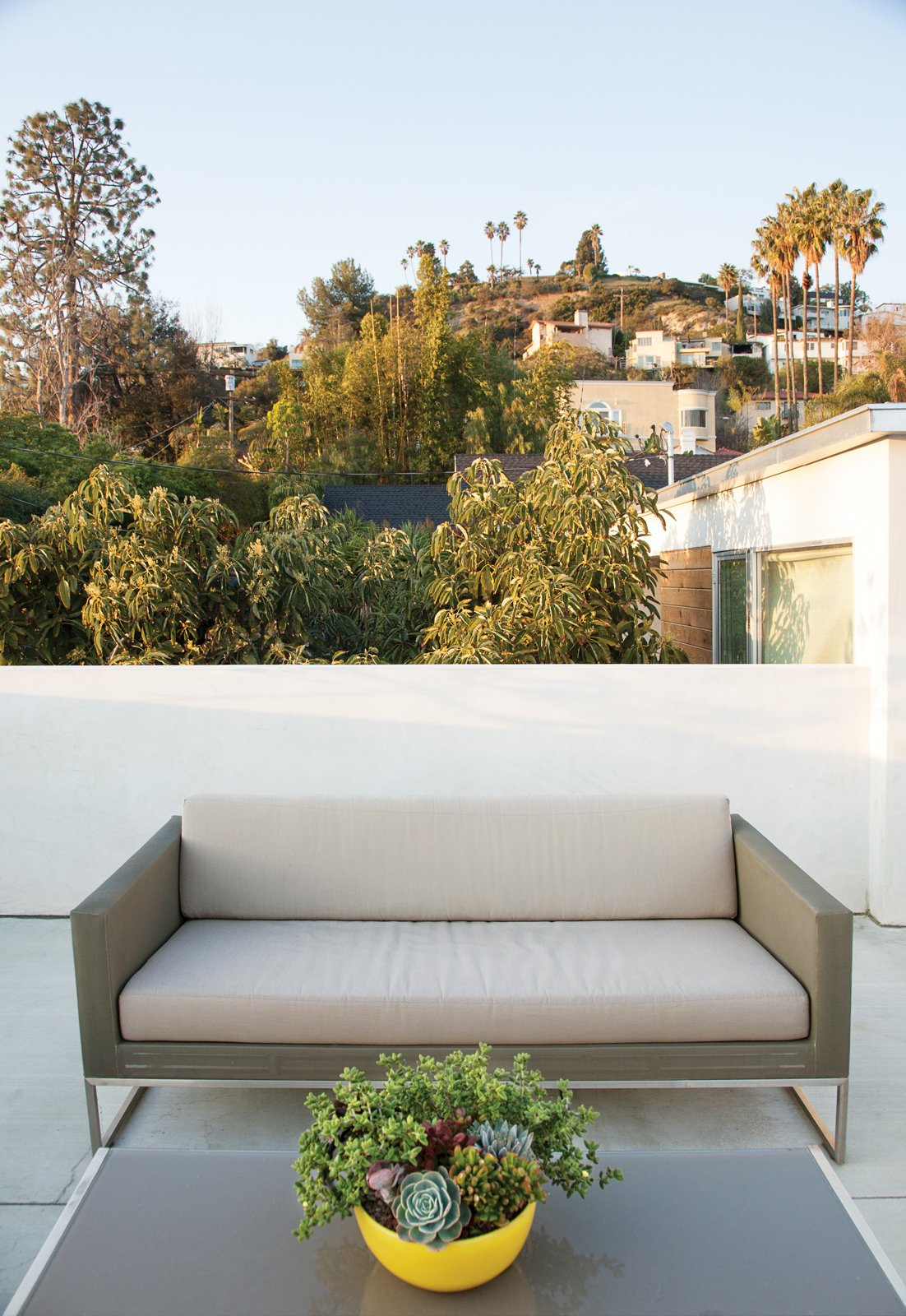 Outdoor and Small Patio, Porch, Deck Jacobs transformed the roof into a series of decks, this deck features Crate & Barrel's Dune sofa and coffee table.  Photo 5 of 13 in The Modern Renovated Home of Glee Star Jayma Mays