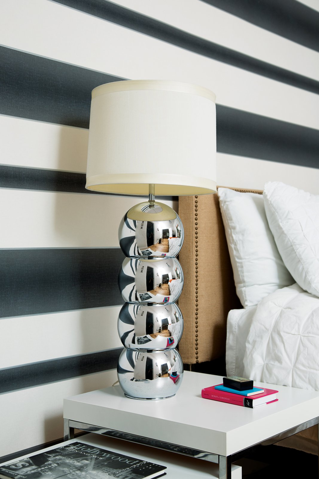 Bedroom, Table Lighting, Night Stands, and Bed Mays chose Graham & Brown's Verve Stripe wallpaper for the downstairs bedroom. The chrome lamp is vintage.  Photo 1 of 13 in The Modern Renovated Home of Glee Star Jayma Mays