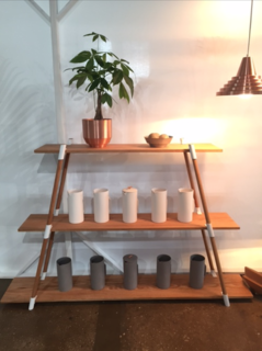 Florida-based studio Yield displays a number of its modern home goods, including the French Press coffee makers, Spun Planter, and Meso Pendant Light.
