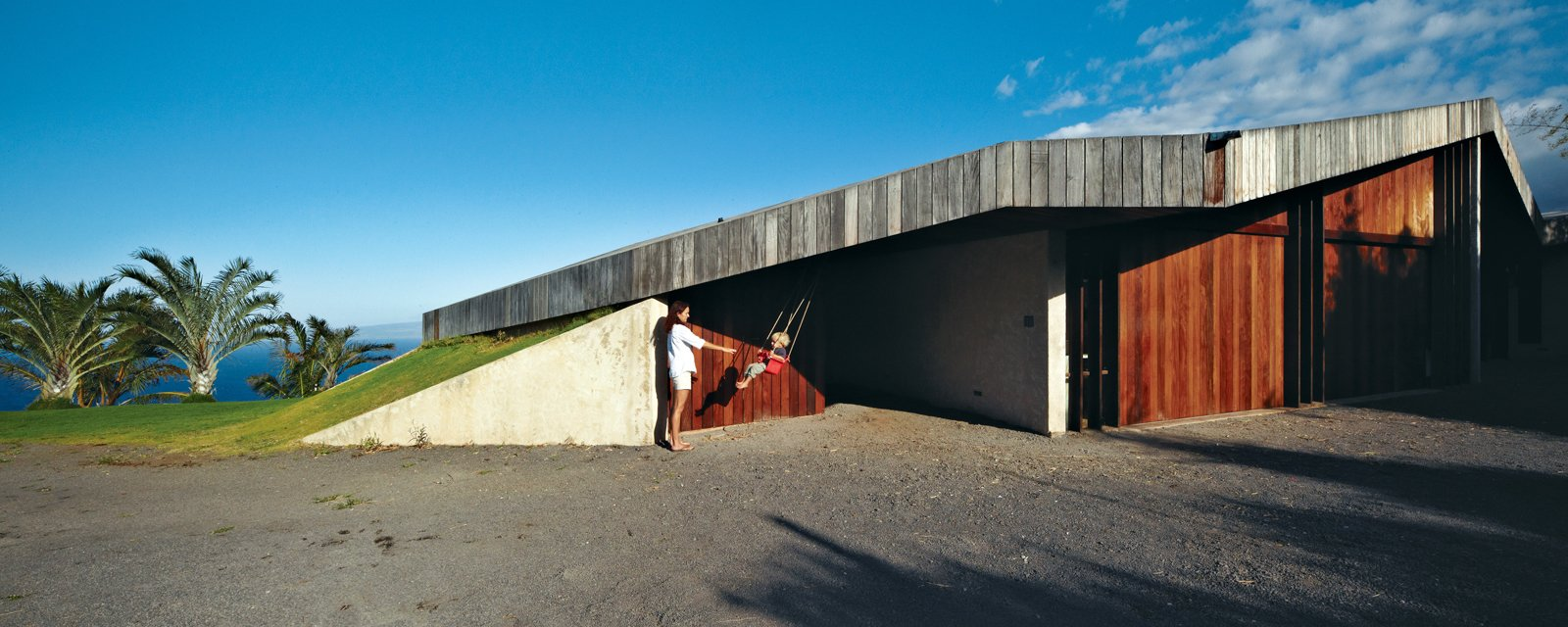 Exterior and Wood Siding Material There are no paints, lacquers, or polyurethane finishes used anywhere in the house. Indoors and out, the materials were kept simple: The exterior walls and roof are oiled ipe, selected for its hardness and weather resistance.  Photo 10 of 10 in Clifftop House with Angled Roof in Maui