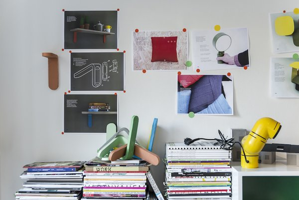 Architect and industrial designer Jonas Wagell's studio, in an old milk factory in the Södermalm section of Stockholm, includes photographs and sketches suggesting his preference for color and straightforward, minimal style.