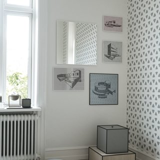 Located in Denmark, Kristina Dam Studio is a multifaceted design studio founded by designer Kristina Dam. The studio is focused on connecting the worlds of graphic design, interior spaces, and art. Shown here in By Lassen's Illustrate Frames alongside the View Mirror, Kristina Dam's architectural prints are striking accents that blend digital printing and hand drawing.  Her framed prints include the Abstraction House, Danish House, Finn Juhl House, Mountain House, Simpel House, and Tree House Illustrations.