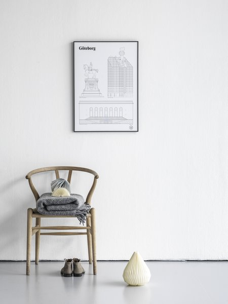 "Despite its minimalist rendering, each Landmarks Print from studio esinam includes intricate details that show the differences between the landmarks. The Gothenburg Landmarks Architectural Print includes architectural drawings of three iconic places in the Swedish city including the historic Kopparmärra statue, the Läppstiftet building—nicknamed ""lipstick"" for its shape and color—and Göteborgs Konstmuseum, Gothenburg's famed art museum."