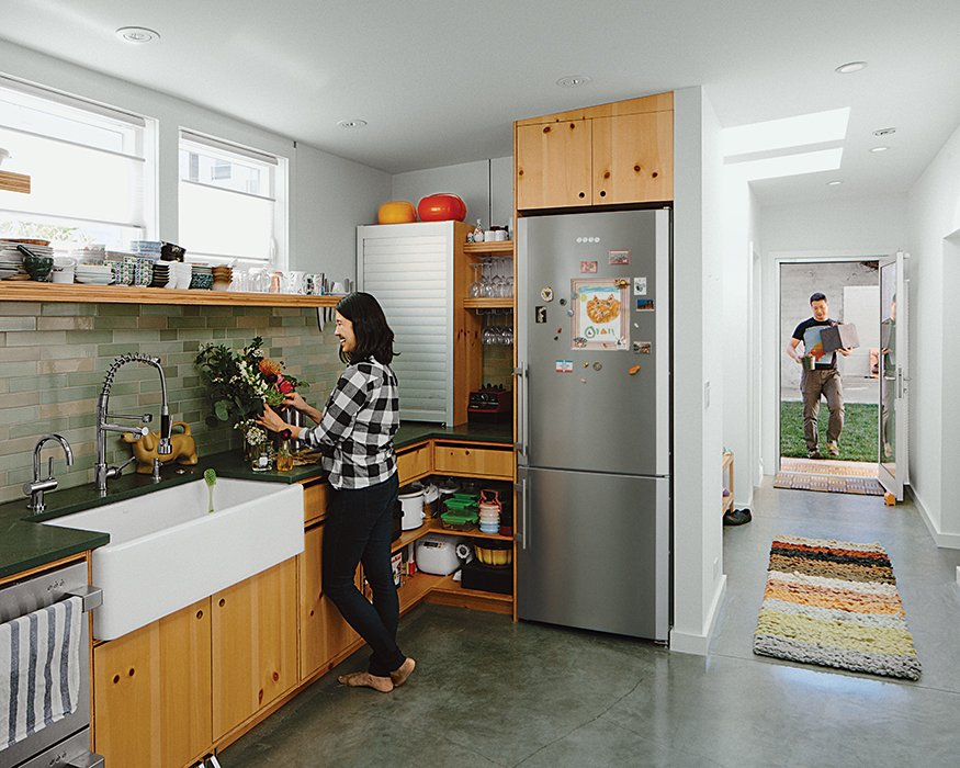 Kitchen, Ceramic Tile Backsplashe, and Refrigerator The kitchen features custom casework by Peter Doolittle, dark-green slate countertops from Hamilton-Schwarzhoff, and a Heath Ceramics backsplash.  Photo 3 of 11 in Abandoned Industrial Compound Becomes a Modern Home Base