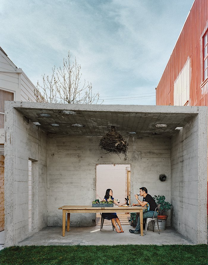 """Dining Room, Chair, and Table The couple uses the pavilion for outdoor dining. From there, the property opens to a small courtyard, and finally culminates at the main house, which holds one bedroom, a kitchen, a living-dining space, and a """"flex"""" room.  Photo 10 of 11 in Abandoned Industrial Compound Becomes a Modern Home Base"""