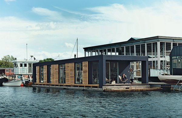 Lisbeth Juul and Laust Nørgaard drew upon their years of experience living on the water to design and build an 860-square-foot floating home in Copenhagen Harbor. The home's minimal form and furnishings reflect the residents' desire to downsize following three years on land.