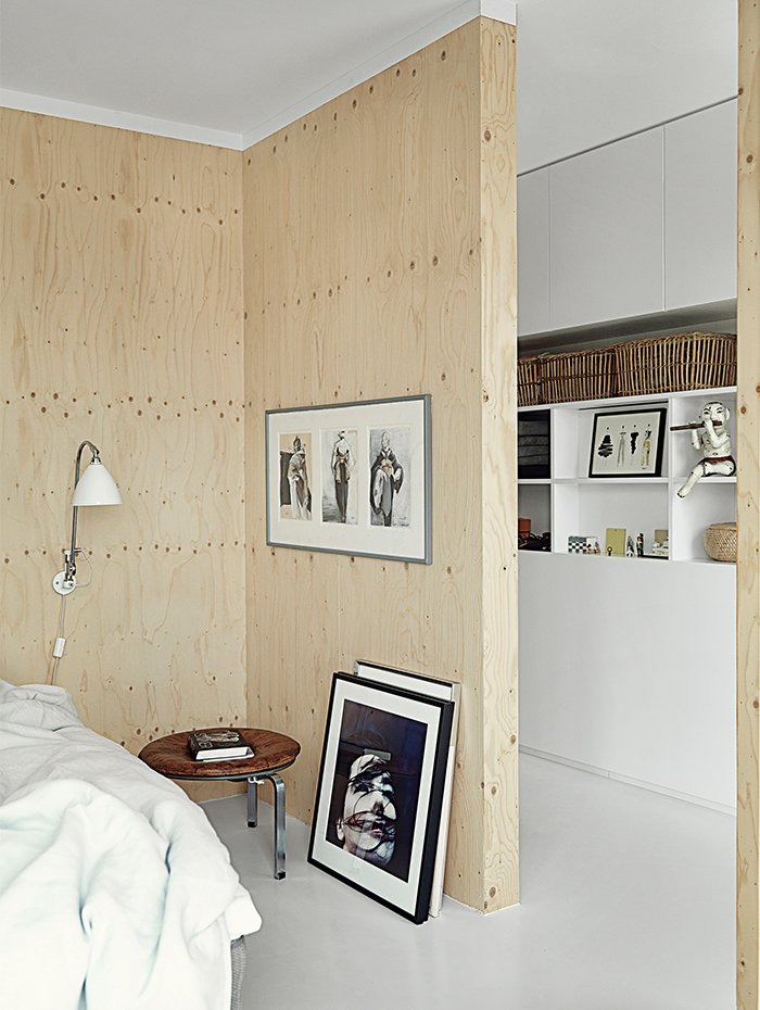 The sparsely decorated room features a PK33 stool, DUX bed, and framed photo of Björk by Anton Corbijin. Tagged: Bedroom, Bed, Night Stands, and Lamps.  Photo 7 of 9 in Each Day at This Floating Home Begins With a Swim, Just Two Feet From Bed