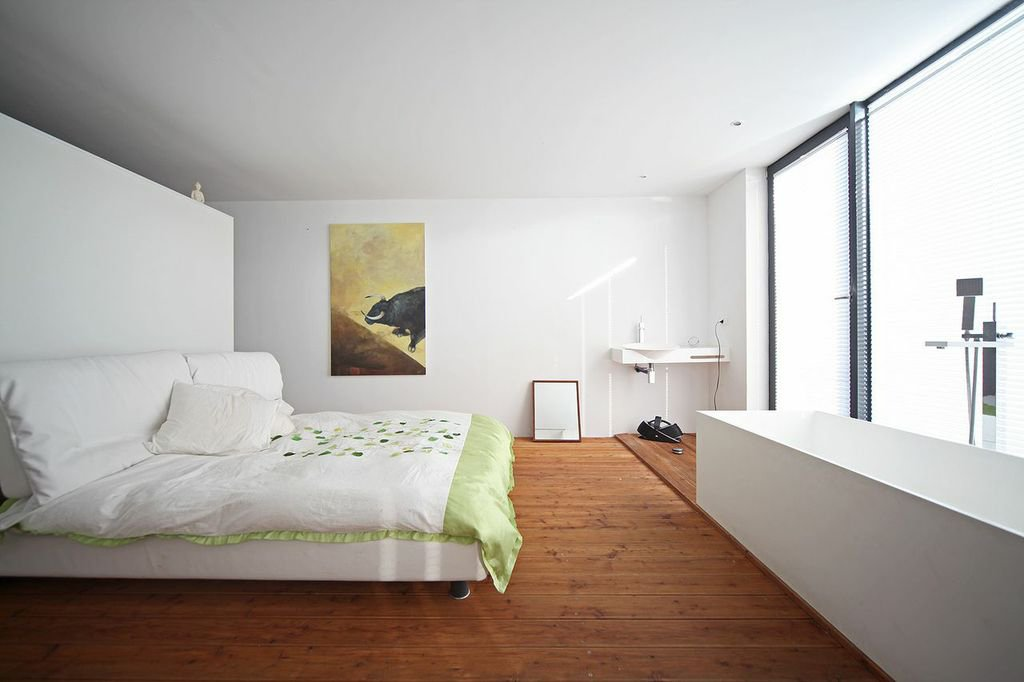 """""""Most [floating homes] are reinvented boats with an unhealthy condensation inside, translated into humidity. In my house the smell is wood and it has a healthy proportion of humidity.""""  Bedrooms by Dwell from Minimal Floating House in Poland"""