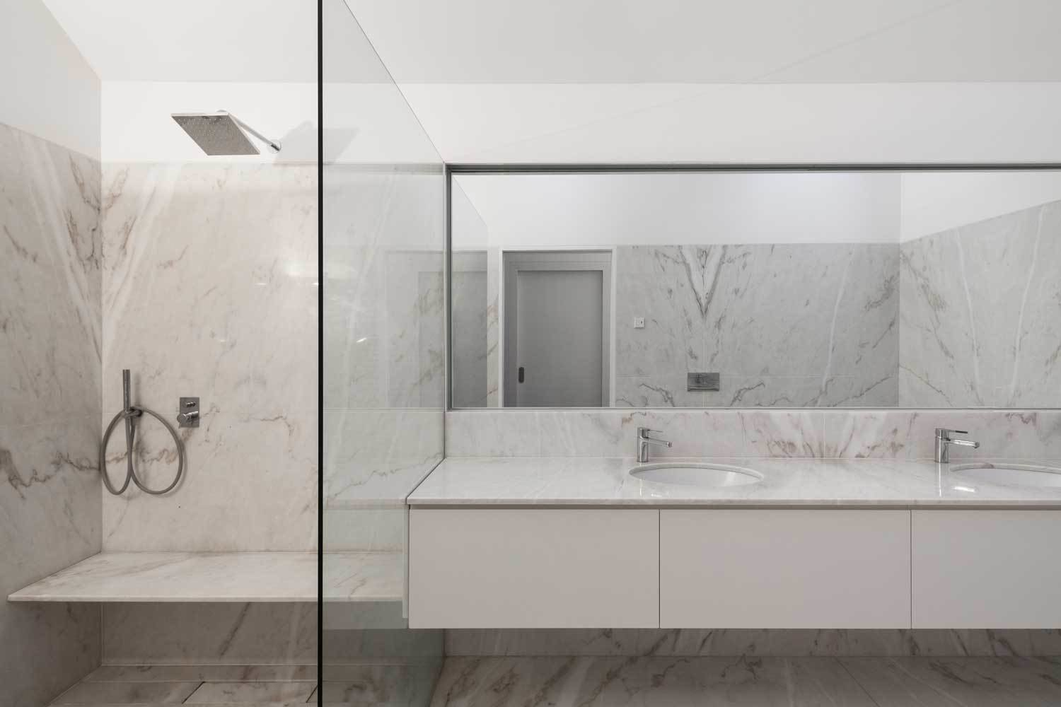 Bath Room, Marble Counter, Undermount Sink, Marble Floor, and Enclosed Shower The bathrooms are lined in luxurious Estremoz marble.  Best Photos from House of Four Houses