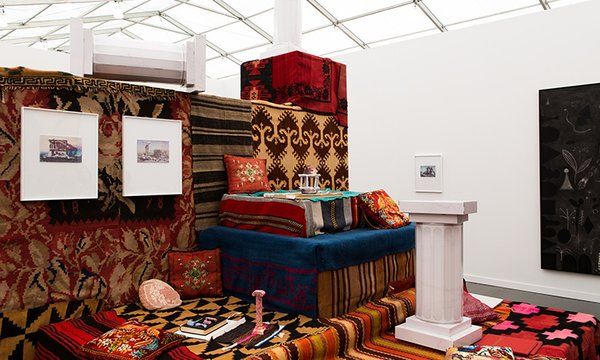 """Athens gallery The Breeder's booth featured Andreas Agelidakis' carpet-draped """"Crash Pad,"""" a chill-out spot featuring architectural miniatures, books, and hanging artwork."""