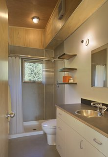 The entrance is immediately flanked on its left by a mudroom for hiking gear and the bathroom.