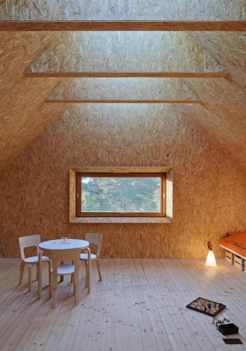 Glulam beams keep the interior column free and enable a large skylight that runs the length of the roof.  Photo 2 of 5 in This Island Retreat Practically Embodies Simple, Rugged Scandinavian Design