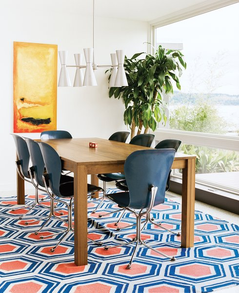 In this Issaquah, Washington, renovation, a Jill Rosenwald rug adorned with a blue-and-orange hexagons adds a vibrant note to the dining area.