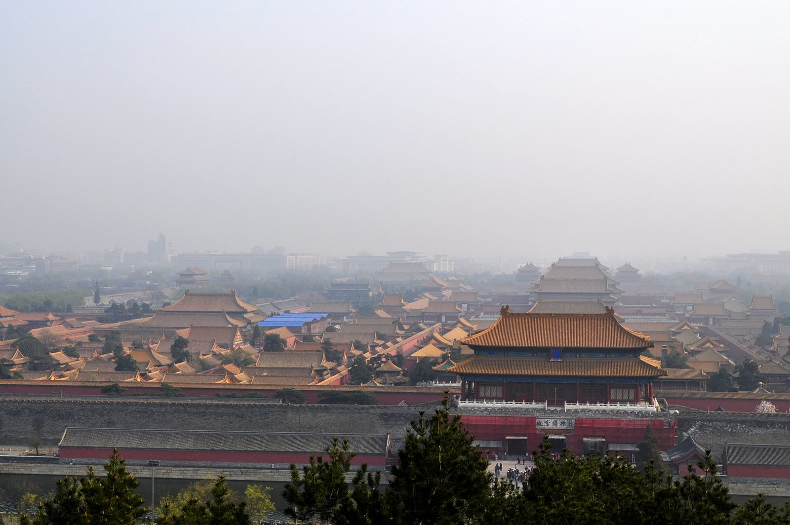 A climb to the top of the hill at the center of Jingshan Park, situated just north of the Forbidden City, offers the best views of Beijing. Here, one can take in a skyline that displays the city's stark contrast between the traditional and contemporary.  Photo 1 of 10 in 10 Places to Visit in Beijing