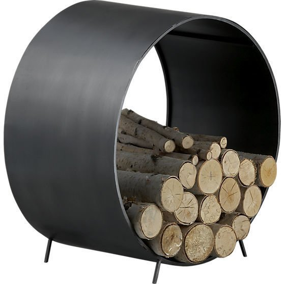 The Chuck wood storage unit, $99 from cb2.com, is made from iron and is elevated off the ground to ensure air circulates so the kindling doesn't collect moisture.  Creative Ways to Store Firewood by Diana Budds