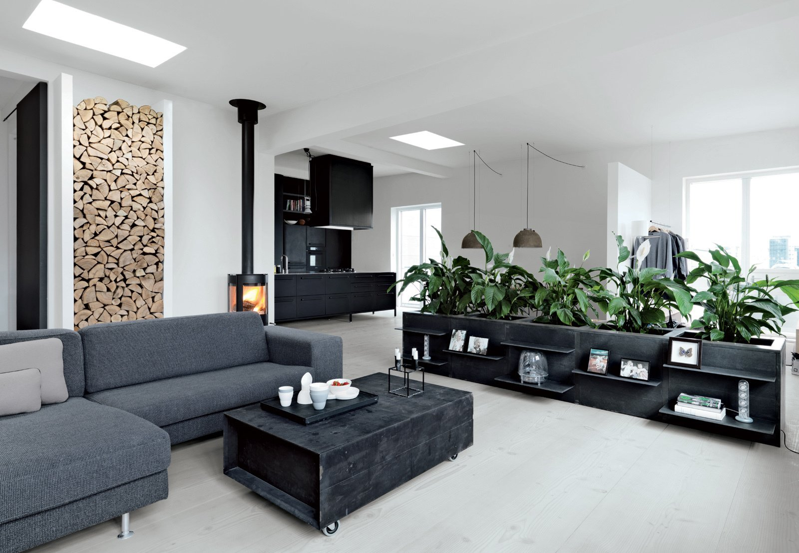 In this sleek monochromatic loft in Denmark, the residents built a nook to store wood, which turns the logs into an artful display.  Creative Ways to Store Firewood by Diana Budds