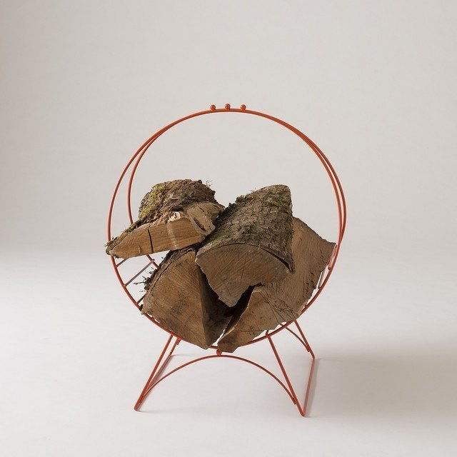 Schoolhouse Electric's Metal Hoop Stand, $99, holds a few logs—good for those who burn the occasional fire.  Creative Ways to Store Firewood by Diana Budds