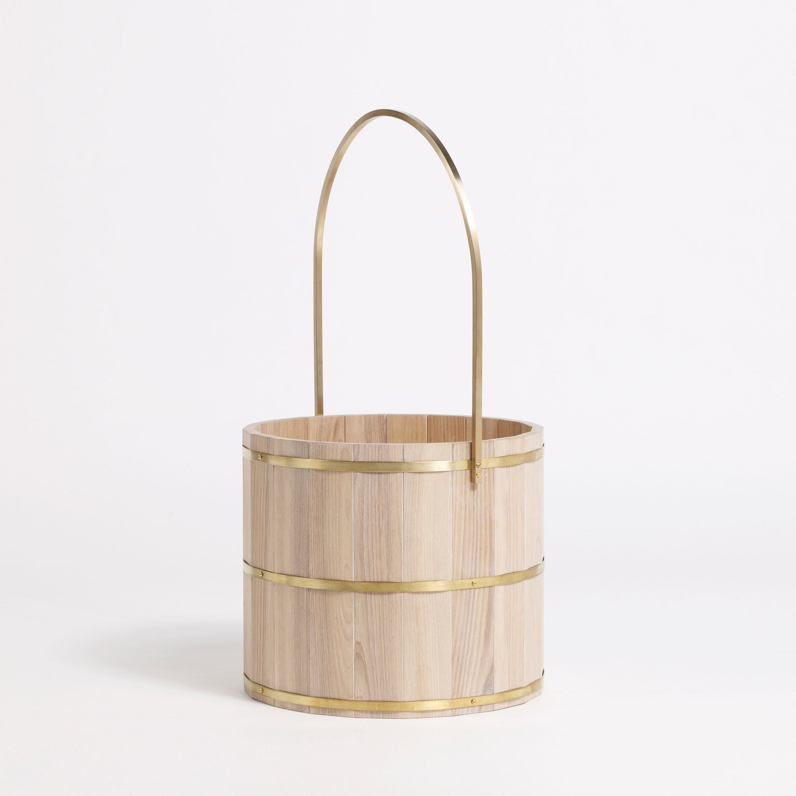 Another Country's Bucket ($600) is inspired by Finnish sauna accessories and is made from ash and brass.  Creative Ways to Store Firewood by Diana Budds