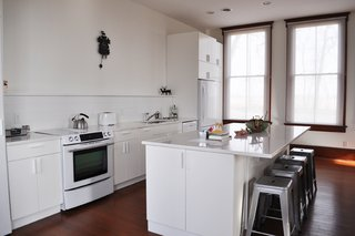 The updated kitchen boasts new cabinetry and appliances.