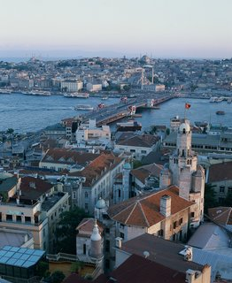 The view from the Galata Tower in Istanbul, Turkey overlooks the Galata bridge and an assortment of rooftops which are nestled along the edge of the Beyoglu district. Photo by: Cristóbal Palma