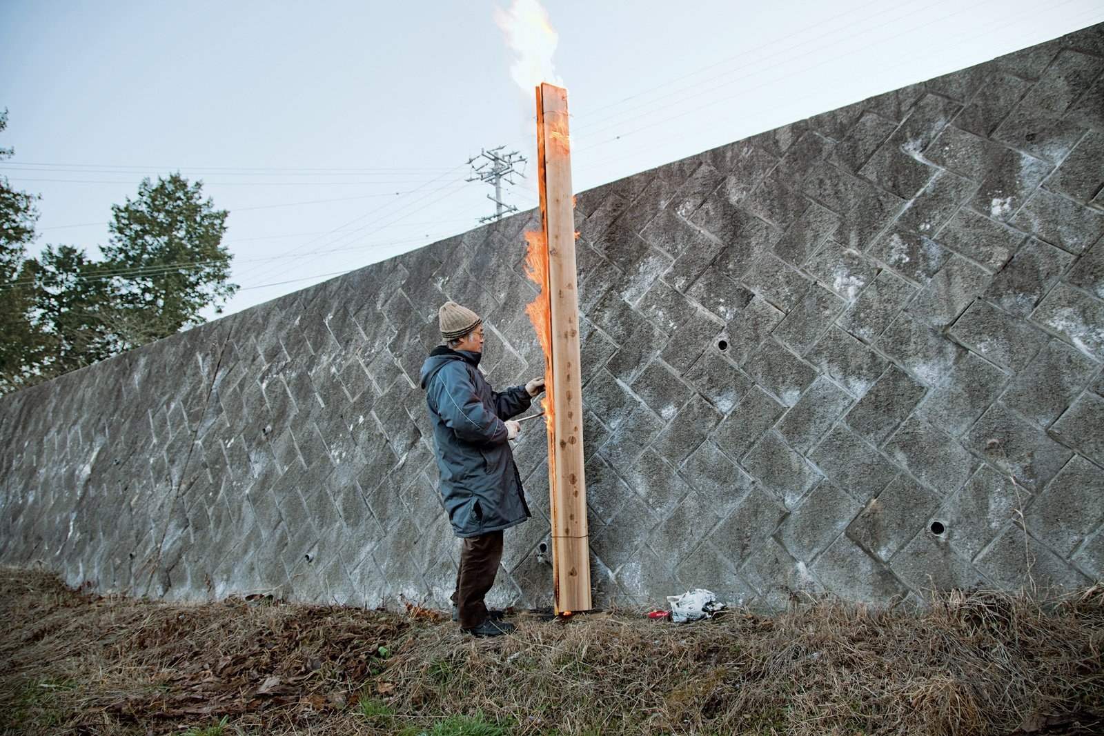 Once the fire is evenly distributed across the length of the board, it is simply a matter of patience.  Steps: How to Make Charred Cedar Cladding by Jaime Gillin