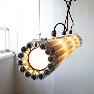 "Made from recycled fluorescent bulbs, steel, rubber and hardware, the Recycled Tube Light measures 8"" x 69"" and is a great example of creative upcycling. Photo courtesy of Matter."