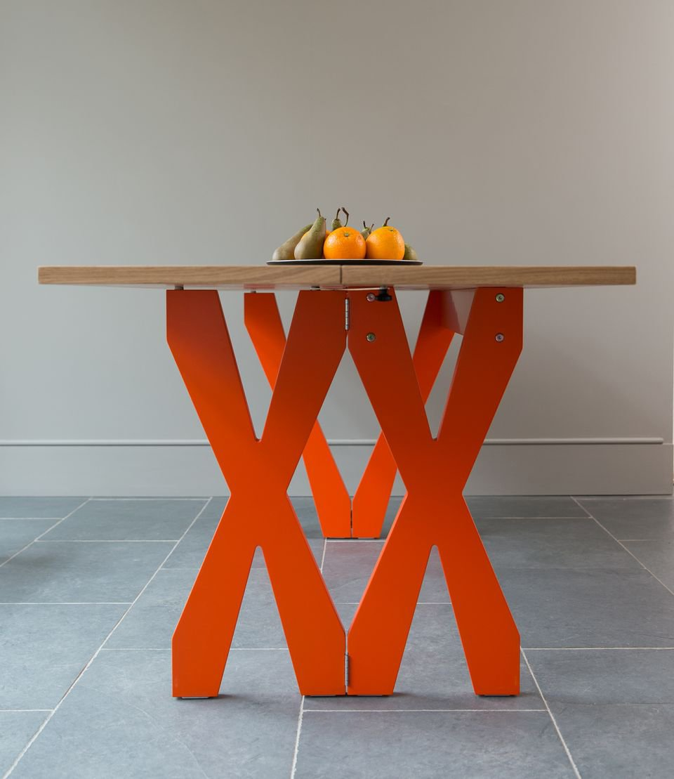 The Double Cross table offers a playful punch of color with sophisticated practicality. The 'X' base doubles up so the table can be easily made half the size.  Sustainably Sourced Furniture by Steuart Padwick by Vanessa Corrêa