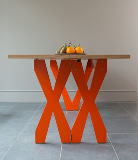 The Double Cross table offers a playful punch of color with sophisticated practicality. The 'X' base doubles up so the table can be easily made half the size.