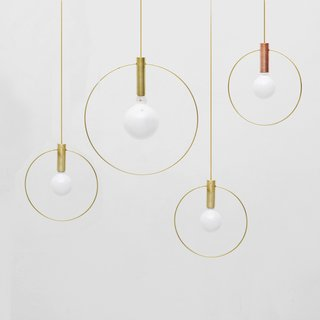 Aura LightsA pared down pendant lamp that comes in a brass or copper base and a 10-or 15-inch brass ring. From $345