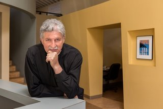 Edward Mazria  The architectural advocate and activist next to the Architects Pollute cover story that helped spur action against climate change and jumpstart his organization Architecture 2030, which aims to help make the building sector carbon neutral by 2030.