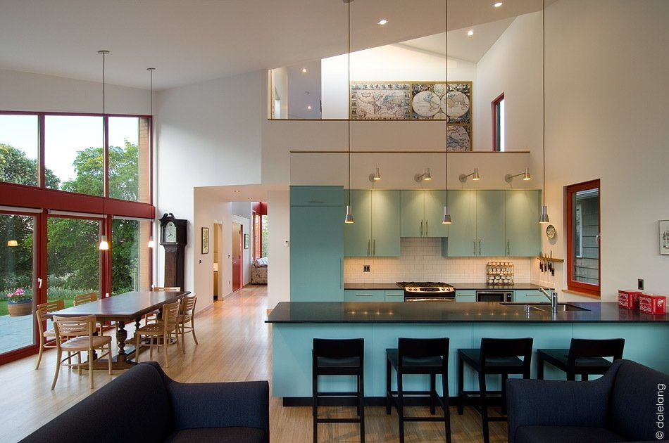 Kitchen and Colorful Cabinet The kitchen window was designed to look into the Goodchilds' daughter's home.  Photo credit: Dale Christopher Lang PhD AIAP  Photo 7 of 15 in Get Ready For July 4th With 15 Spaces That Rock Red, White, and Blue from Angular Multi-Generational Home in Washington