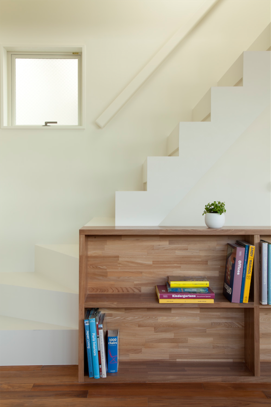 The staircase was painted white to promote uniformity of design.  Half & Half House by Laura C. Mallonee