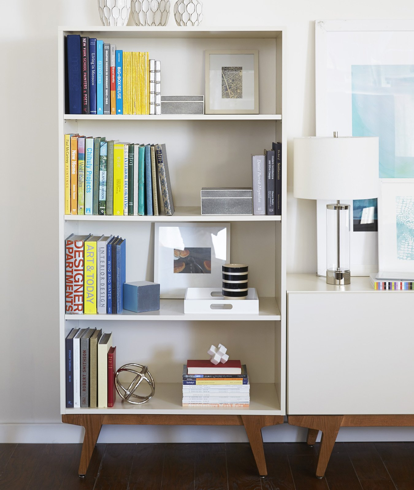 """Storage Room and Shelves Storage Type This bookshelf and storage credenza are part of the """"Modern"""" collection.  Photo 4 of 7 in The Art of Arranging: 6 Tips on Creating Stylish Shelf Displays from These Modern Workspaces Are Just As Welcoming as Your Living Room"""