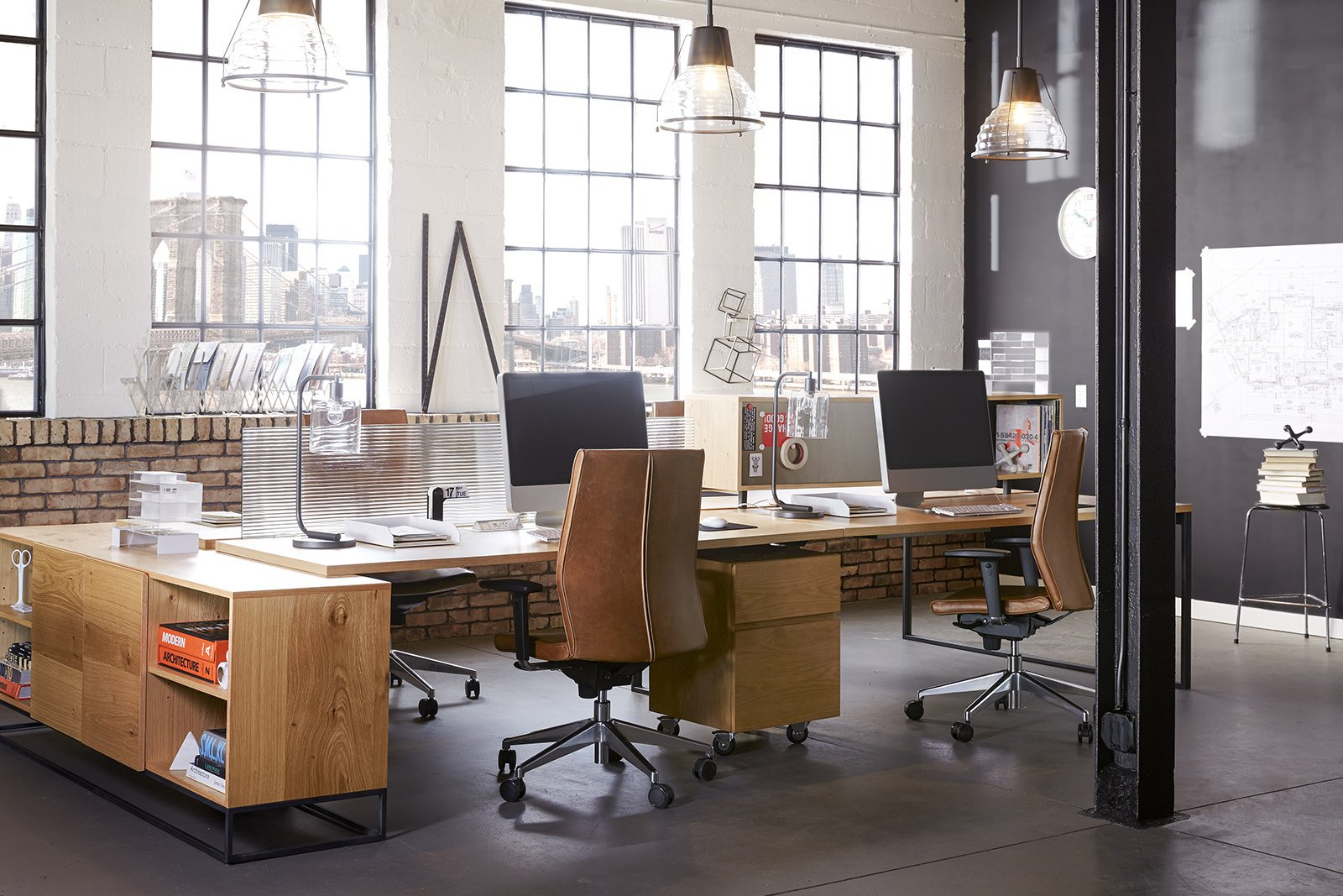 """""""There is a tendency for office environments to feel cold and sterile, but our solutions afford us the opportunity to completely transform this common practice,"""" Hannoosh says.  Photo 8 of 9 in These Modern Workspaces Are Just As Welcoming as Your Living Room"""