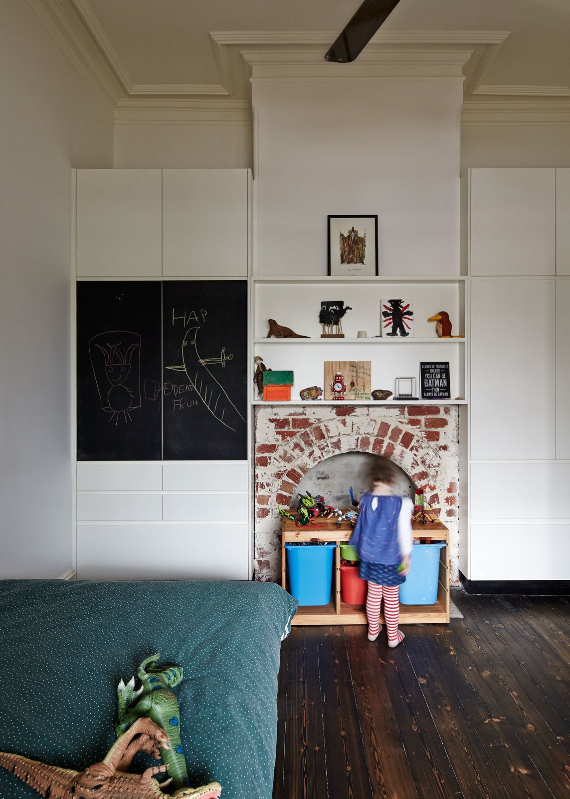 """The house's unique Victorian-era fireplaces had been obscured over the years with mock surrounds. The architects stripped them bare to """"reveal their materiality,"""" as Bright explains.  M House by Laura C. Mallonee"""