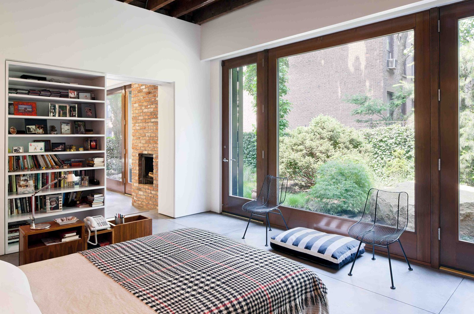 Bartlett's bedroom is in a ground-floor addition that was built onto the back of the building about 50 years ago. It is adjacent to her painting studio.  Photo 1 of 8 in This Spacious Home in a Former Warehouse is Part Art Gallery
