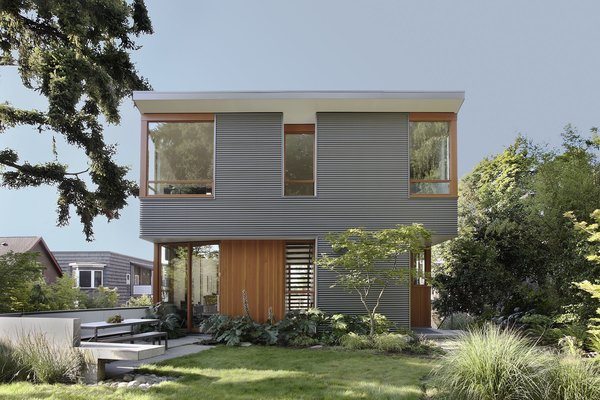 """Durability drove the selection of metal panels,"" Schaer says of the home's industrial exterior. Manufactured by AEP SPAN from corrugated cladding, it looks like zinc but costs significantly less. It also contrasts nicely with the natural siding and trim. ""All of the wood inside and out is Douglas Fir, the predominant wood species in the northwest,"" Schaer explains."