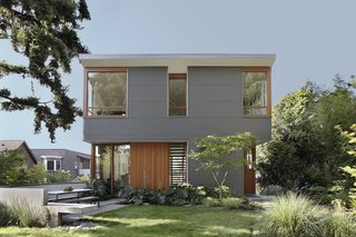 """""""Durability drove the selection of metal panels,"""" Schaer says of the home's industrial exterior. Manufactured by AEP SPAN from corrugated cladding, it looks like zinc but costs significantly less. It also contrasts nicely with the natural siding and trim. """"All of the wood inside and out is Douglas Fir, the predominant wood species in the northwest,"""" Schaer explains."""
