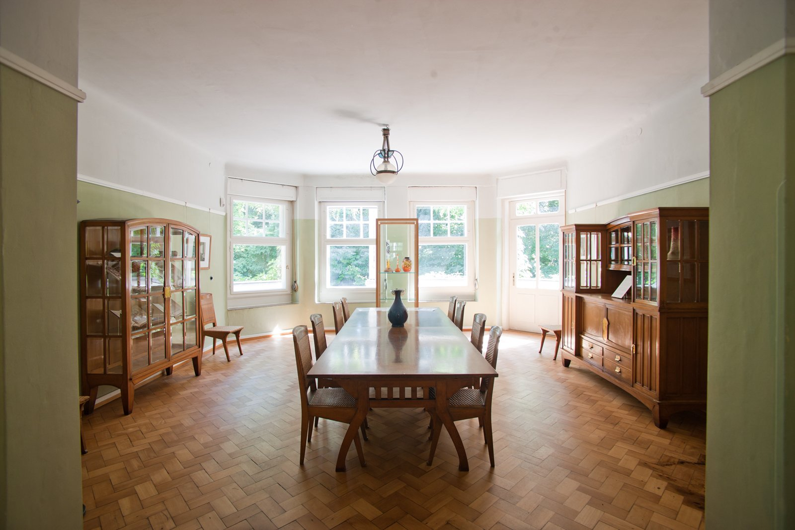 Hendy van de Velde's house, Hohe Papplin Haus in Weimar. Note the bowed out large windows, very Art Nouveau in design, that let in an abundance of natural light. Van de Velde designed the furnishings to match the shape of the room.  Photo 4 of 4 in Art Nouveau Architect Henry van de Velde