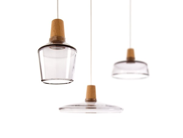 Made from hand-blown glass and wood, the Industrial Pendant Lamp from Kaschkasch Cologne for DWR, can hang alone or as a trio.