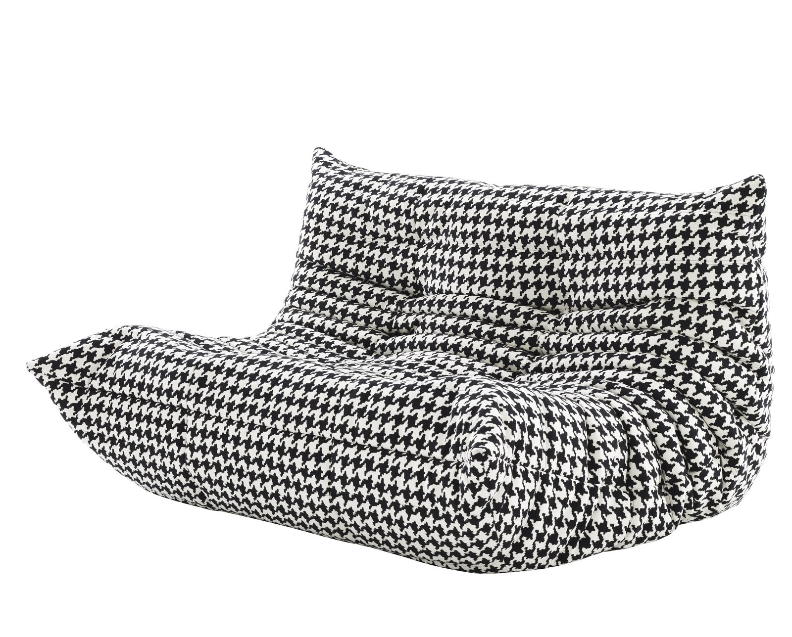 To celebrate 40 years of Michel Ducharoy's iconic Togo sofa, Ligne Roset is releasing the collection in two new upholstery patterns, including the black and white houndstooth seen here.  Checking In On WantedDesign 2013 by Sara Carpenter
